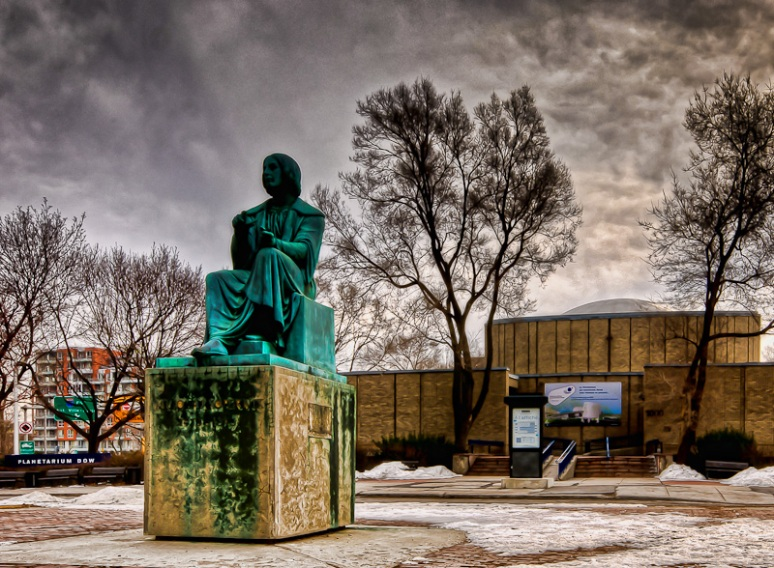 Monument to Polish astronomer Nicholas Copernicus at the Dow Planetarium
