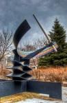 Equatorial sundial sculpture by Herman J. van der Heide