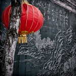 Chinese lantern and slate wall mural in Place Sun Yat-sen