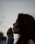 Blowing bubbles in support of student protesters