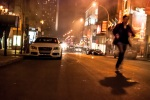 Protester running from police tear gas