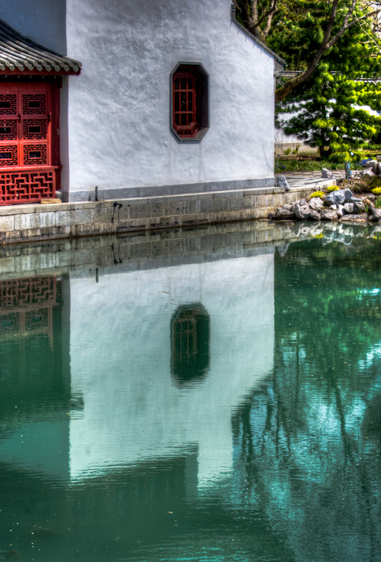 Reflections of the Bateau de Pierre building in the Dream Lake Garden