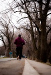 Runner on bike path at Parc La Fontaine