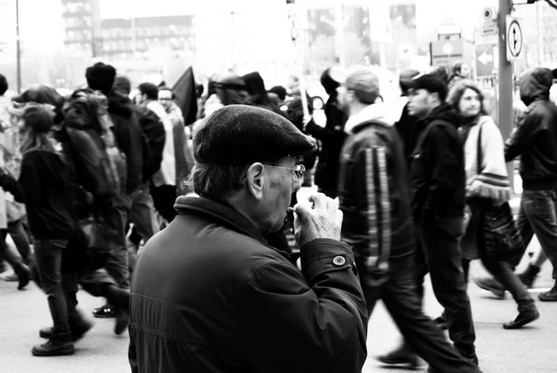 Elderly man watches protest