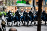 Mounted Police charge up rue University