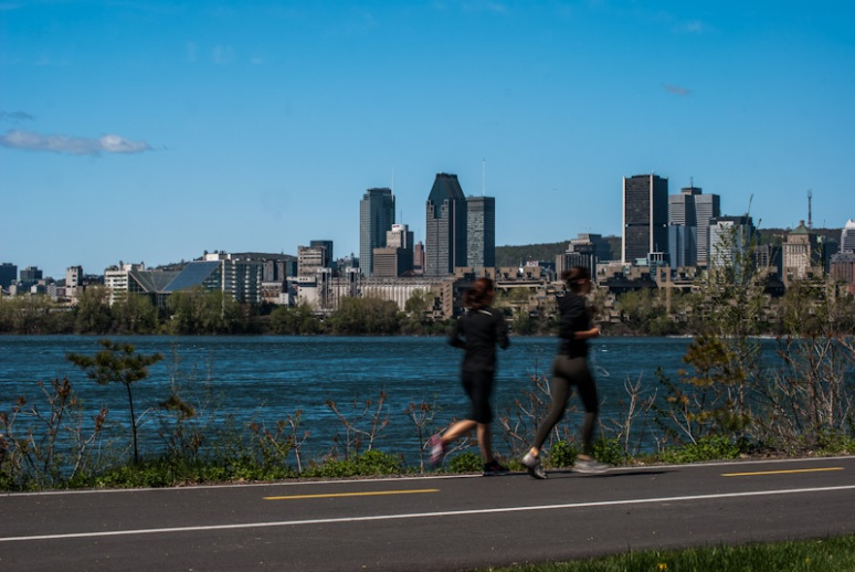 Joggers with view of Montreal skyline