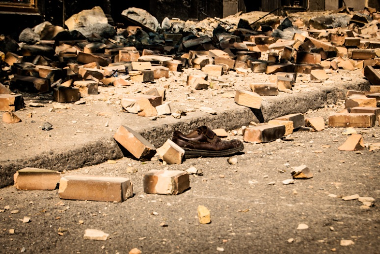 Victims shoe surrounded by rubble