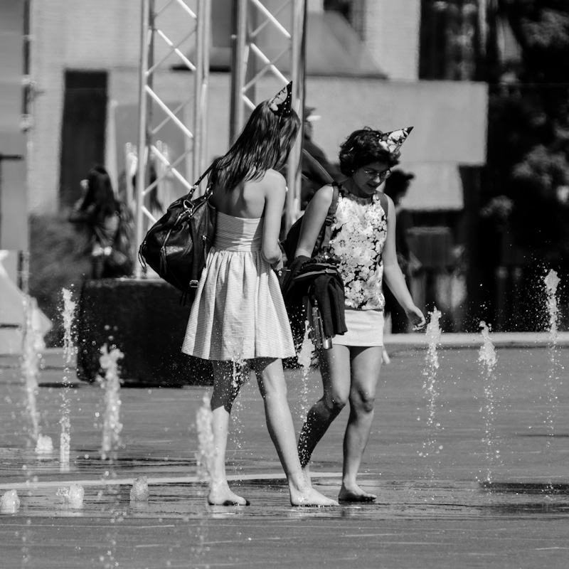 Party girls cooling off in the fountains