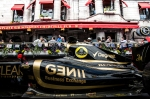 Lotus F1 car overlooked by crowded bar terrace
