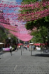 Canopy of pink baubles along rue Sainte Catherine