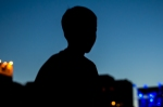 Silhouette of boy enjoying the music