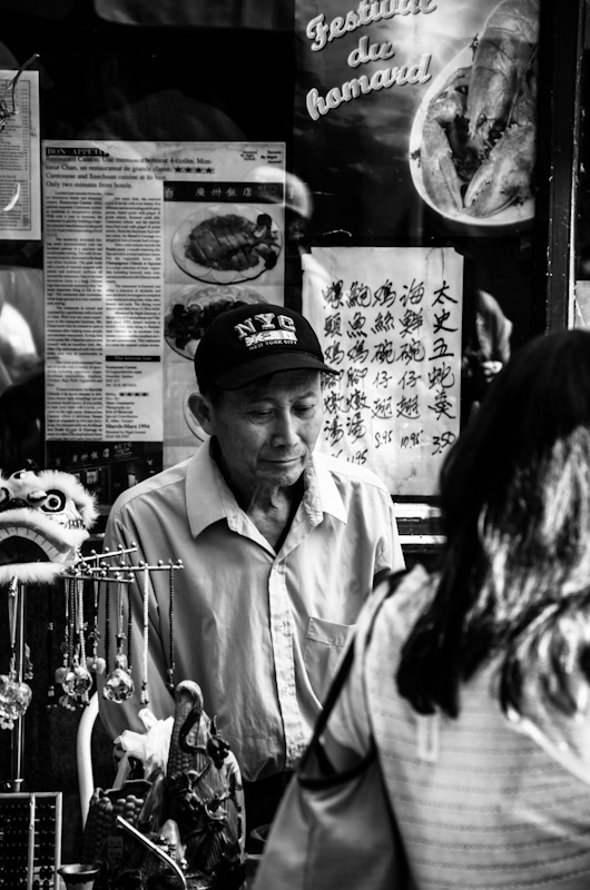 Stall vendor at Chinese street sale