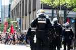 Riot police follow protesters on Maisonneuve