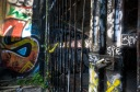Graffiti and locked entrance to the Wellington tunnel
