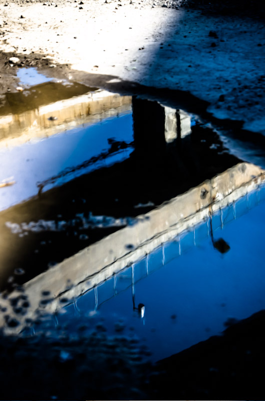 The Turcot Interchange reflected in a puddle