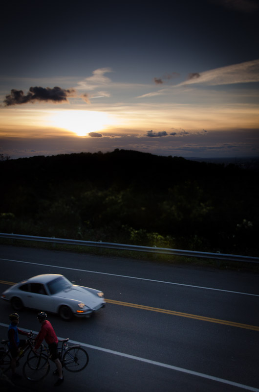 Porsche and cyclists on Mount Royal